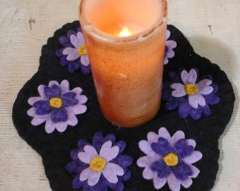 Spring flower candle mat penny rug two tone purples on black