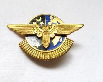 Vintage French military enamel flying bomb insignia w/ blue enamel