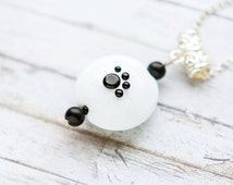 Animal footprint - black and white handmade lampwork glass pendant on a chain with black onyx, ooak, eco-friendly jewelry, kitten paw