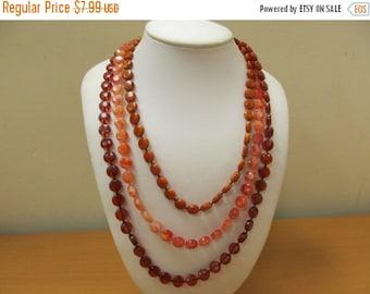ON SALE Vintage Long Shades of Burnt Orange Multi Strand Plastic Beaded Necklace Item K # 2753