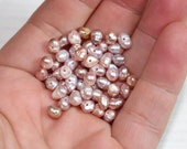 Tiny pink freshwater pearls