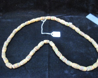 """18"""" string of handmade clay  beads in gentle yellows and blues and greens"""