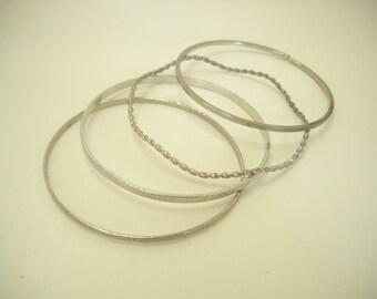 Four Vintage Silver Tone Bangles (6398)