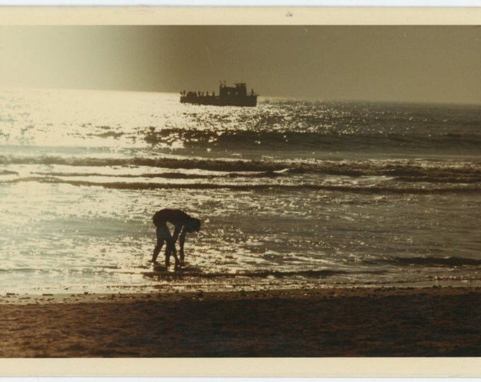 Vintage Snapshot Kodacolor Photo: Silhouetted Figure, Boat, at Beach, 1970 (68494)