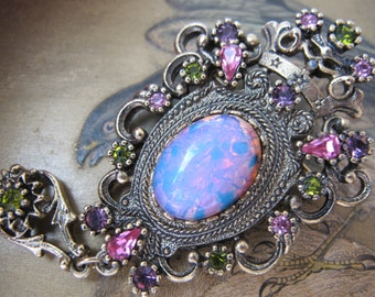 Sarah Coventry Contessa. Renaissance Revival Style.Colorful Glass Opal aka Dragon's Breath Brooch. Pendant Brooch Statement Runway 1970's