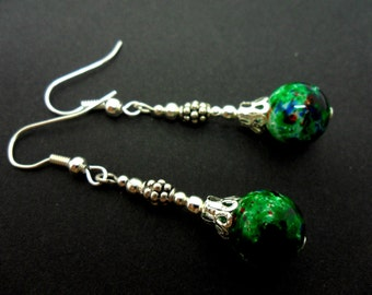 A pair of hand made long dangly green  marbled bead  earrings. New.