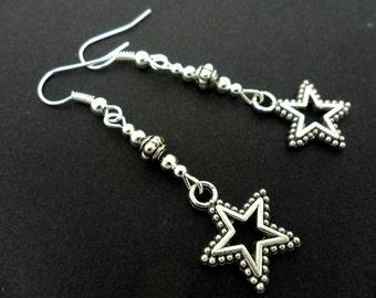 A pair of pretty tibetan silver  dangly  star earrings.