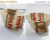 Its a steal 50 Amazing Beaded Bracelet with Orange Gold & Pearl Colored Beads Hook Squeeze Metal Closure, Multistrand w/ Slide Clasp Mad Men