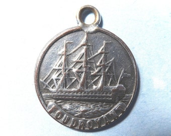 Foudroyant, Nelson's flagship medallion, antique.   It was made from a copper bolt of Nelson's flagship, silver plated.  19th. century.