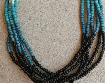 Multi Strand Black Dark Blue Denim Blue Light Blue Seed Bead Necklace with Antique Silver Aztec Pendant and Cone Ends