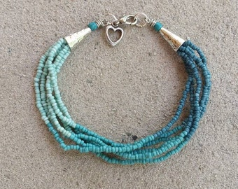 Multistrand Light Blue Dark Blue Denim Blue Ceramic Seed Bead Bracelet with Silver Heart Charm and Cone Ends