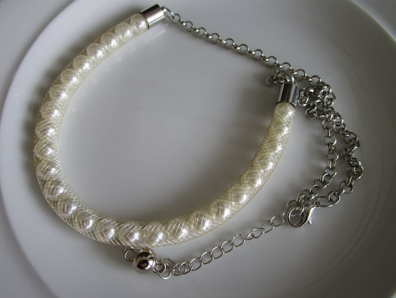White pearl bead necklace in white mesh cover with silver tone