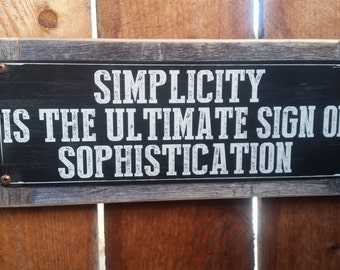"Recycled wood framed ""Simplicity is sophistication"" street sign"