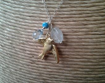 bird and  blue gemstone necklace
