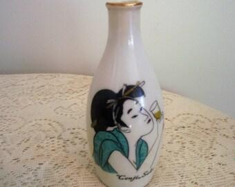 Japanese Sake bottle, White sake bottle with lady drinking, trimmed in gold, Genjin sake bottle, ceramic Asian vase.collectible Asian bottle