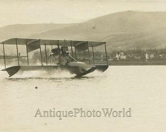 Curtiss pantoon biplane airplane antique photo