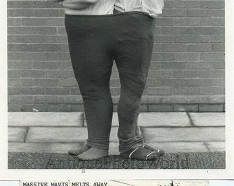 Couple wearing one huge pair of pants fun vintage photo
