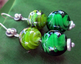 sterling silver dangle earrings with swirly green glass round beads.