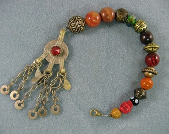 Long pirate style beaded clip with tasseled kuchi coin