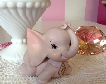 pink vintage elephant figurine