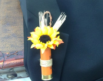 Shotgun shell boutonniere designed for fall with a sunflower