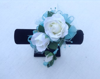 Wrist corsage and matching boutonniere in soft aqua