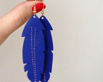 feather earrings made with cobalt blue leather