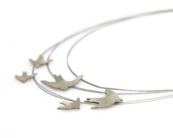 a SWALLOWS NECKLACE