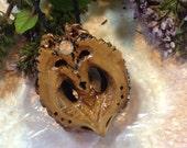 SunWolf- Carved black walnut with Oregon Sunstone
