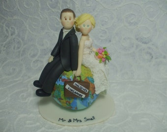 Personalized bride and groom on the globe wedding cake topper