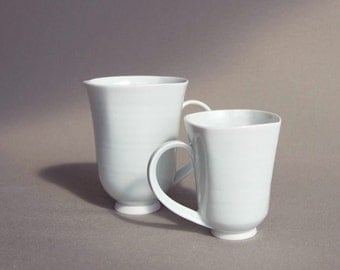 Pair of 2 finely thrown white porcelain cups.