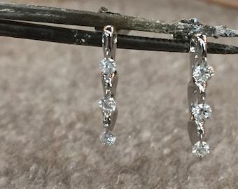 14k white gold dangle diamond earrings .27 carats.
