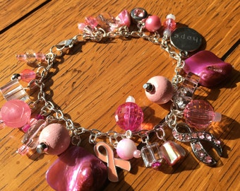 Pink Charm Bracelet with Breast Cancer Awareness Charms. 7.75 inches.