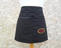 Black half apron with six pockets.  Vendor apron. Simple Black Apron. Craft apron. Server apron. Barista. Cafe Apron. Item No. LDC0200