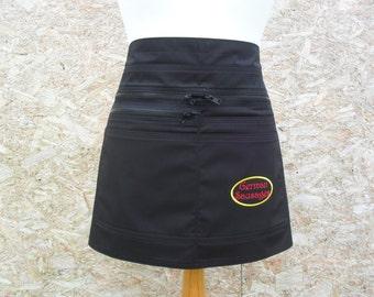 Black half apron with six pockets.  Vendor apron. Craft apron. Server apron. Barista / Cafe Apron. Bartender apron. Item No. LDC0200