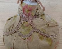Antique pin cushion doll in silk clothes