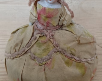Antique pin cushion doll in silk clothes
