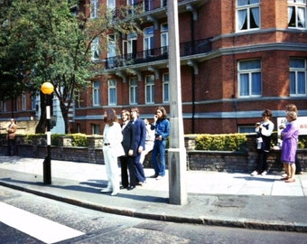 The Beatles at there Abbey Road photo shoot .