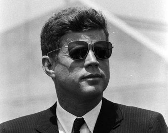 John F. Kennedy , Kennedy looking cool in his Ray Band sunglasses.