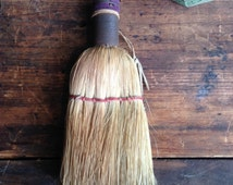 antique whisk broom / straw hand broom / straw broom with leather and wool case