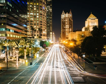 Traffic and buildings along 5th Street at night, in downtown Los Angeles, California. | Photo Print, Stretched Canvas, or Metal Print.