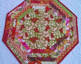 Quilted Table Topper.  Table Runner. Bright orange, greens and golds. Centerpiece. Octagonal, Approx. 21 inches across.