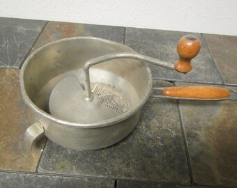 vintage  FOLEY FOOD MILL , Masher , strainer . * hand crank mill with wood handles mid century
