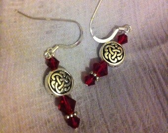 Ruby red Swarovski crystal and silver pierced earrings with Celtic knot beads.