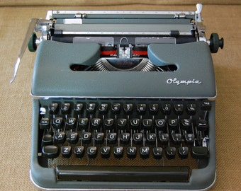 Vintage 1950's Olympia Typewriter, excellent condition, all functions work well, comes with hard case , Germany