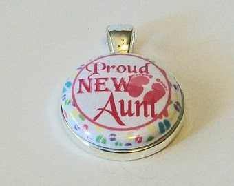 Pink and White Proud New Aunt Round Silver Pendant Charm