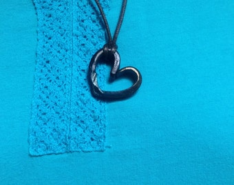 Blacksmith forged heart pendant