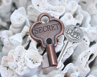 "Set Of Two Keys ""SECRET"" Brass Tone & ""LIFE"" Silver Tone"