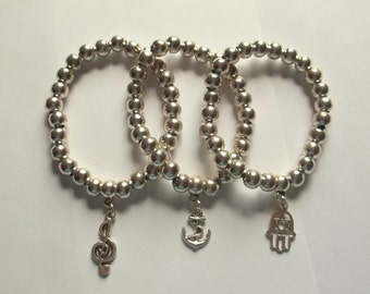 Elastic bracelet with silver tone beads and charms