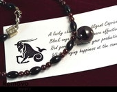 CAPRICORN NECKLACE - Red Garnet Pendant and Black Onyx Beads